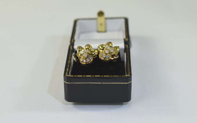 Pair of 18 Carat Gold Diamond Earrings in the form