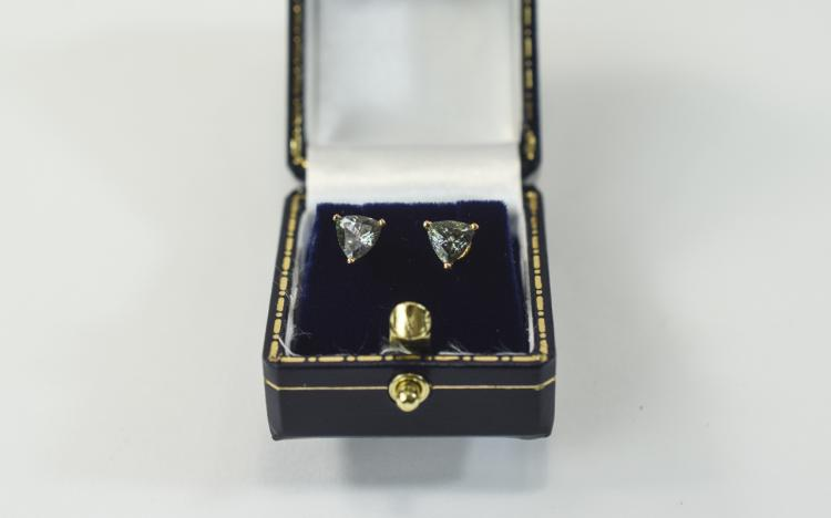 Pair of 9 Carat Gold Stud Earrings. Each set with