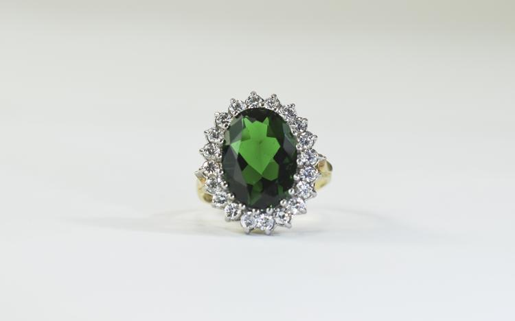 9 Carat Gold Dress Ring set with central green sto