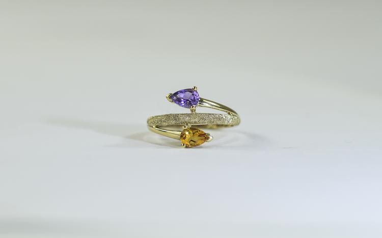 9 Carat Gold Dress Ring set with 2 round pear shap