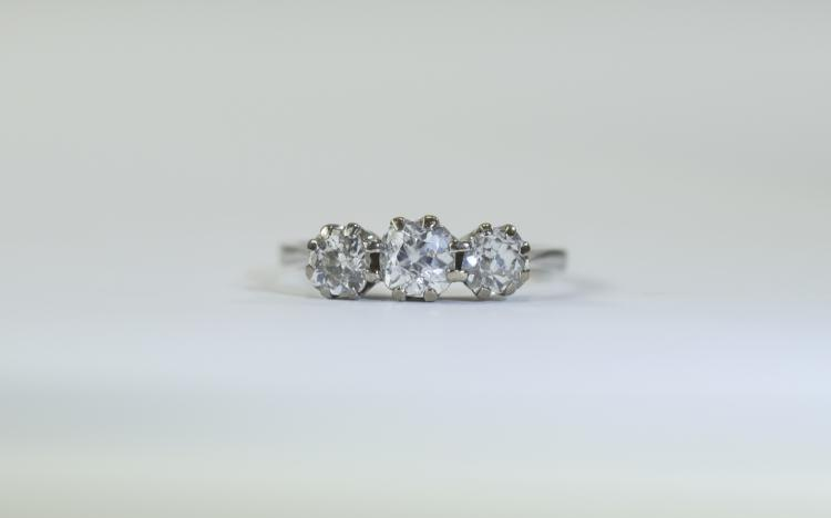 Platinum 3 Stone Diamond Ring set with cushion cut