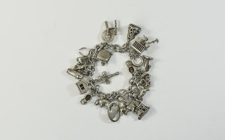 A Good Vintage SIlver Charm Bracelet Loaded with 2