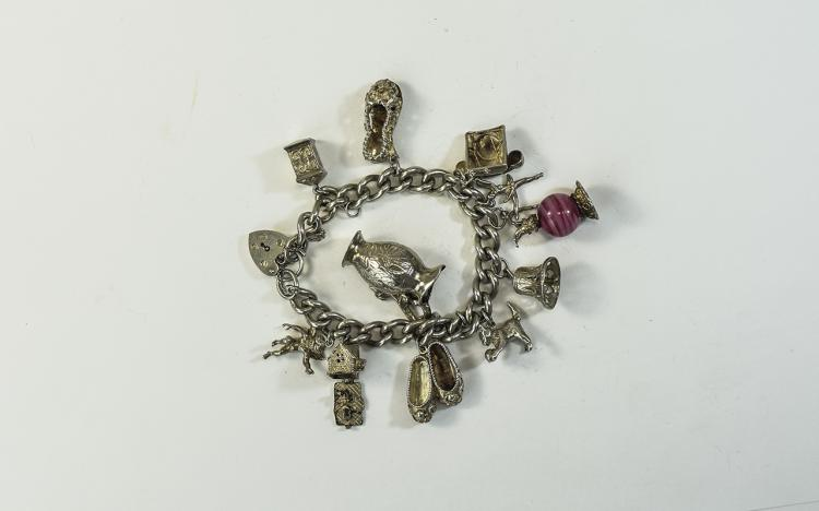 A Vintage Silver Charm Bracelet, Loaded with 11 So