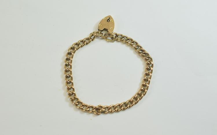 A 9ct Gold Curb Bracelet with Padlock. Fully Hallm