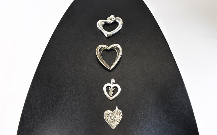 Collection of 4 Silver Heart Shaped Pendants
