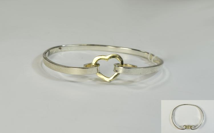 Silver Bangle with heart shaped gilt fastener. Sta