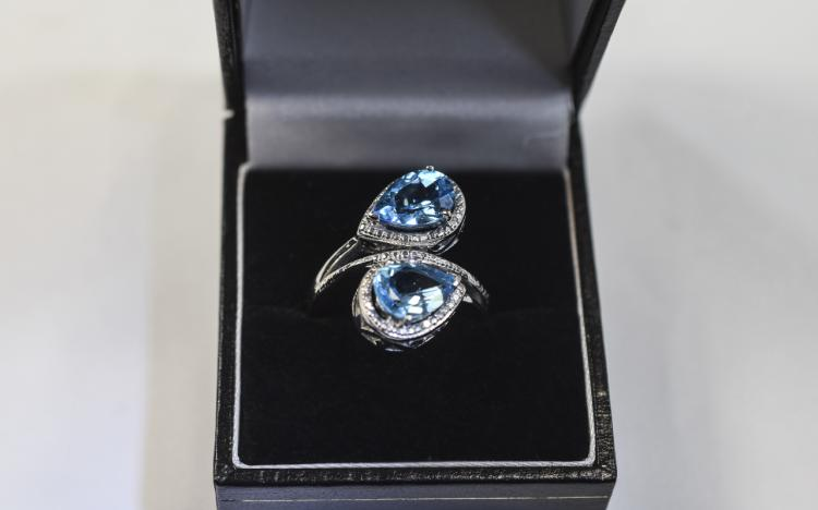 Swiss Blue Topaz Crossover Ring, two pear cut ston
