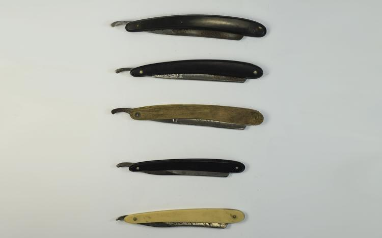 A selection of five vintage cut throat razors with