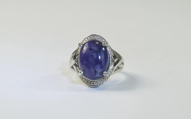 Purple Opal Ring, an oval cut cabochon of one of t