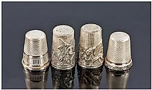 Four Silver Thimbles. One featuring an embossed