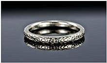 A Platinum Ring with Stylised Floral Decoration to