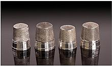 A Set of Four American Silver Thimbles. Each with