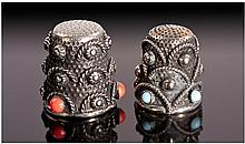 A Pair of Silver Thimbles. The oxidized outer