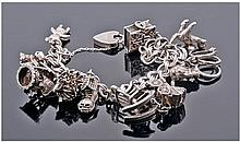 Silver Charm Bracelet Loaded With 11 Charms,