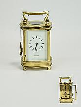English Superb Quality Heavy Vintage Brass Cased Key wind Mechanical 8 Day Carriage Clock. From H. Samuel. c.1950's - 1960's, Features Glass Panels, Visible Escapement, Compensate Balance, White Porcelain Dial, Black Numeral Markers with Key. 5.5