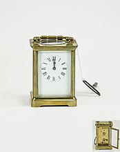 French 19th Century 8 Day Brass Carriage Clock, Marked ACC To Back Plate. Chamfered Glass Panels, White Porcelain Dial, Visible Escapement. 4.5 Inches High. Good Condition - Working with Key.