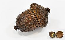 A Superb German Carved Coqvilla Nutmeg Grater of acorn form, the screw off