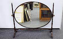 Georgian Style Mahogany Oversized Dressing Table Mirror, Oval Pivoting Mirror Raised On Turned Supports And Cross Stretcher On Short Splayed Feet, Height 33 Inches, 36 Inches Wide