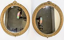 Pair Of Oval Ornate Framed Gilt Mirrors Two mirrors with decorative molded