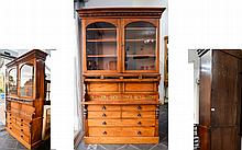 Victorian Large Mahogany Office/Shop Unit. Glazed top with three adjustable shelves above fall front with fitted interior and three short drawers doors with brass pull handles. The base with four short above two long graduating drawers. Foliage