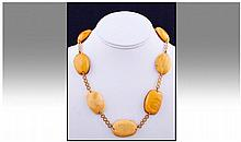 9ct Gold And Amber Necklace. 20 inches in length.