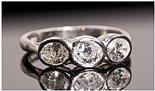 18ct White Gold Set 3 Stone Diamond Ring. The oval