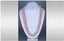 Two Multi Strand Necklaces. One in Coloured Beads,