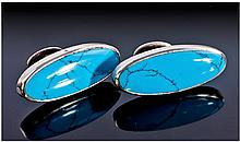 A Pair of Marquise Shaped Silver and Turquoise