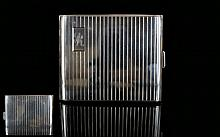 Very Good Quality 1930's Silver Engine Turned Cigarette Case with Regency Stripe Decoration to Front and Back, Gilt Interior. Marked 800 Silver. Size 3.25 x 3.75 Inches. Excellent Condition.