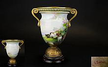 Royal Worcester Early Hand Painted and Signed Twin Handle Vase ' Summers Day ' Cattle at Pasture, Below Lilac / Blossom Trees. Signed Edwin Salter. c.1887. Raised on a Circular Wooden Base. Vase Height 7 Inches. Wooden Base, Requires Attention -