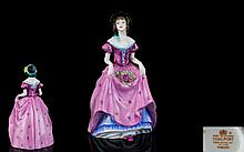 Coalport Early Pre-war Handpainted Porcelain Figurine 'Penelope' Style One Finished in rose pink colourway with blue petticoat and black bonnet. Height, 6.5 inches, issued 1915- 1967  First quality and mint condition