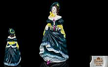 Coalport Early Pre-war Handpainted Porcelain Figurine 'Judith Ann' Fashioned in blue and green dress with yellow shawl and blue green hat. Issued 1915-1967, height 6.5 inches. First quality and mint condition