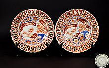 Pair of Oriental Ribbon Plates With Circular reticulated borders. In orange and Delft blue with traditional floral foliate and fan design. Eight and half inches diameter