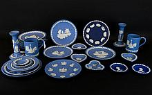 Collection of Wedgwood Jasper Ware, 30 pieces to include, pair of Corinthian style candle sticks 7'' in height, 2 tankards, various assorted cabinet plates & pin dishes etc.... assorted sizes and all decorated in typical classical decoration.