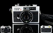 Ricoh 500g (1972) 35mm Film Range Finder Camera with excellent high contrast F.2.8 Rikenon Lens. Made in 1972 with leather strap and case. In Good order. See photo.
