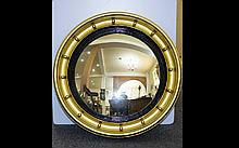 Antique Gilded Circular Convex Mirror Regency style mirror in deep gilt and gesso frame with applied spherical gesso detail. Original hanging chain to back. 21 inches diameter.