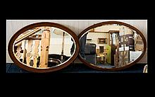 Two Oval Framed Mirrors with bevelled glass and one with chevron in lay to frame, Chain to back for wall mounting. 24 inches high and 34 inches wide.