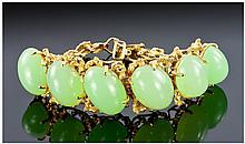 14k Gold Set Jade Bracelet. Set with six quality
