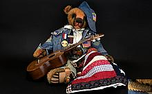 Handmade Jointed 'Archie' Teddy Bear By Simply Victoria Brown mohair bear with vintage USA theme outfit in denim with patches badges and baseball cap. Comes with handmade pioneer quilt and guitar, embroidered tag to nape of neck, good condition,