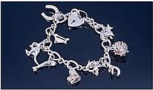 Silver Charm Bracelet Loaded With 9 Charms.