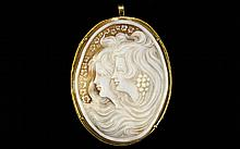 A Very Large And Impressive Shell Cameo Convertible Brooch And Pendant With 18ct Gold Mount An unusually large piece depicting two graces in profile, their flowing hair adorned with grapes, a border of blossoms to left. The whole, of oval form,