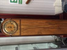 Pale Wood Grandmother Clock Pretty clock with brass dial and small ball fee