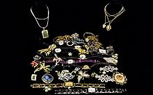 A Large Collection Of Costume Jewellery A varied collection of contemporary and vintage pieces to include several paste set brooches, fashion watches, silver and marcasite set ring etc.