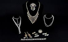 A Collection Of 1950'S Aurora Borealis Crystal Costume Jewellery A wonderful collection of crystal set statement jewellery. Twelve items in total to include, impressive jonquil tone graduated drop necklace with matching brooch and shoulder grazing