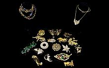 A Large And Varied Collection Of Vintage Costume Jewellery Twenty items in total to include large green crystal set gecko brooch, 1950's gold tone running horses brooch, 1950's bullfighter brooch, large gold tone butterfly set with marquise cut