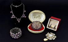 A Collection Of Crystal Set Costume Jewellery Five items in total to include a large and impressive vintage floral bombe shaped brooch set with six rows of faceted crystals in lavender, sky blue and violet. Also, an expanding silver tone bracelet