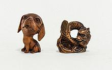 Contemporary Carved Netsuke Two in total, fashioned in dark wood  the first in the form of a coiled dragon, the second in the form of a puppy with cartoon style enlarged head.