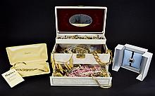 A Jewellery Box Containing A Large Collection Of Mixed Costume Jewellery Three compartment case with inner mirror containing over fifty items of costume jewellery to include several gold tone necklaces by Napier, crystal set clip on earrings, novelty