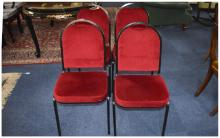 Set of 4 Conference Chairs  With red upholstery with a black metal frame