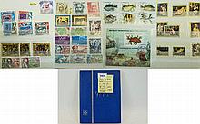 Small blue A5 stock book of around 200 stamps - ea